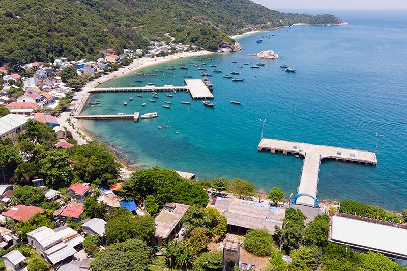 Cham Island village with pier and surrounding clear blue waters
