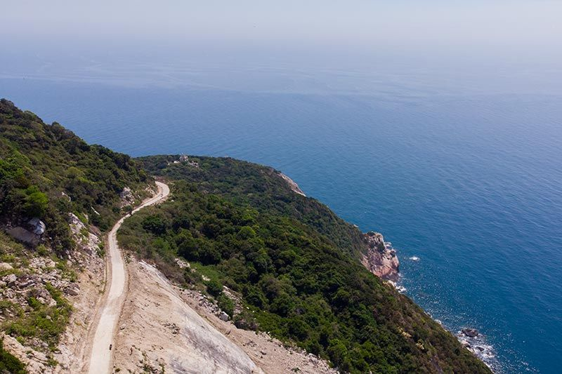 Road along the eastern cliffs of Cham Island with South China Sea