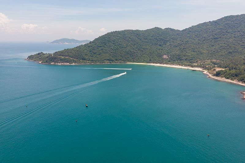 Drone pic of Cham Island with speed boat ferries heading to Bai Ong (Ong Beach)