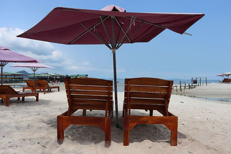 Beach loungers and umbrella in the sand at Starfish Beach