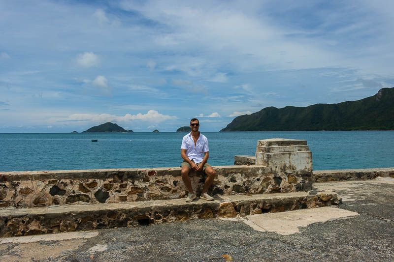Matt Hallowes sitting on the main pier in central Con Dao