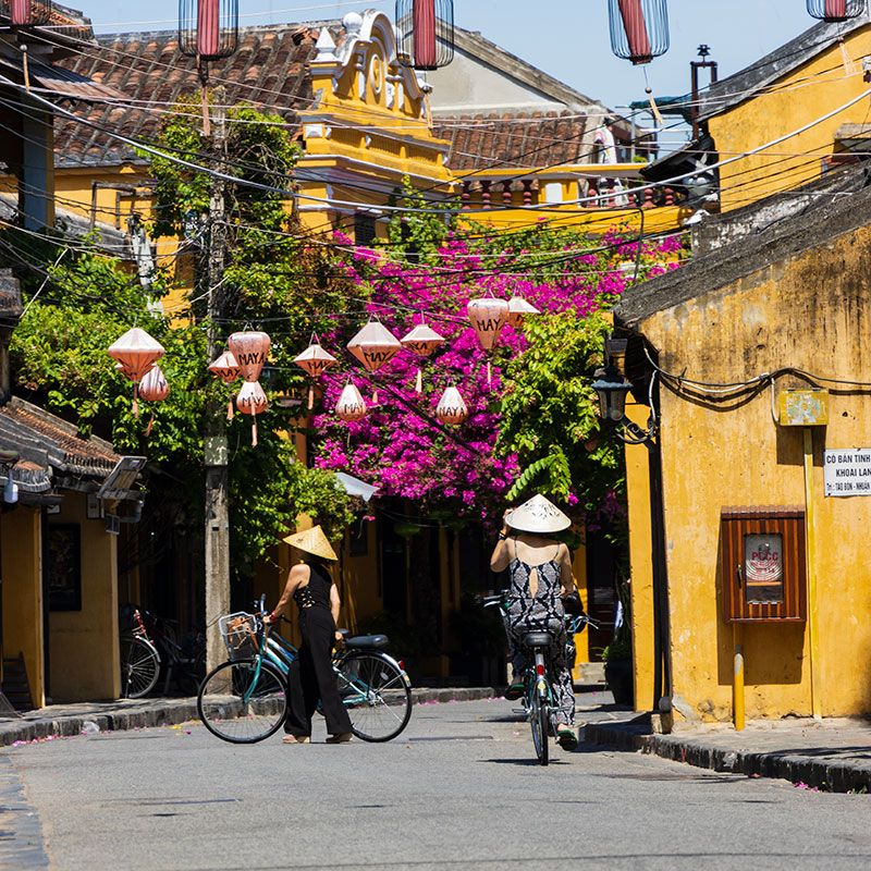 Tourists riding bicycles through the streets of Ancient Town