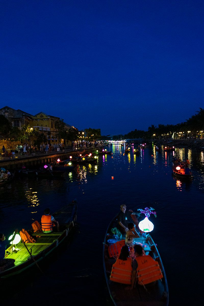 Tourists on gondola boats in Hoi An Ancient Town