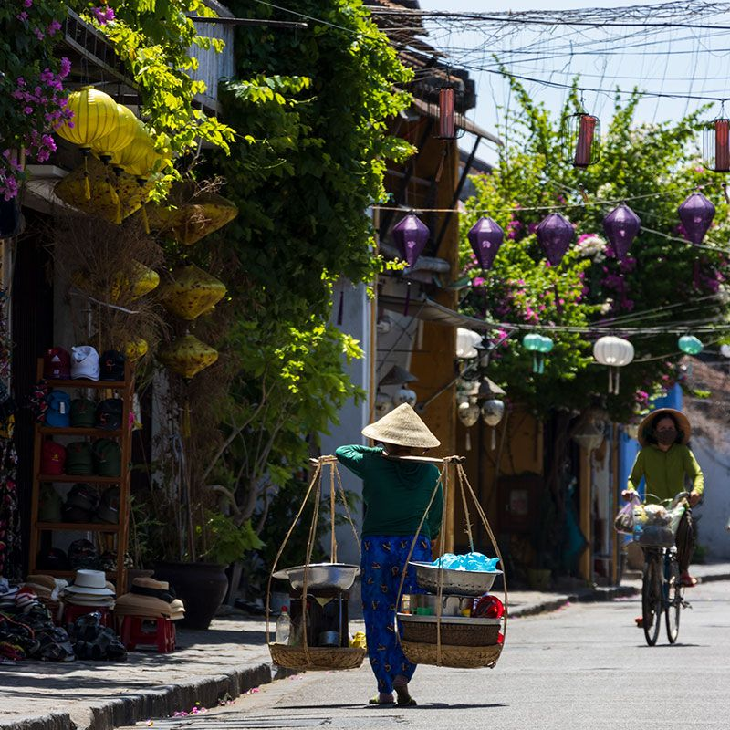 Vietnamese traders going about their day in Hoi An Ancient Town